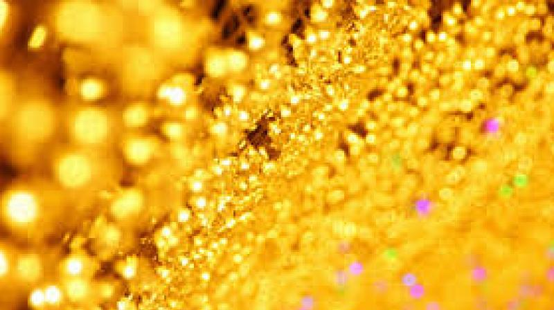 Gold prices softened by Rs 20 to Rs 30,565 per 10 grams