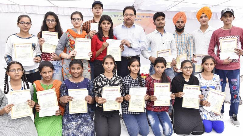 O.P Soni with the matric and 10+2 meritorious students of PSEB 2018 Exams