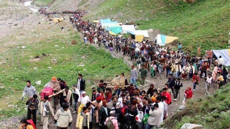 4,956 pilgrims today left the base camp here for the holy cave shrine of Amarnath