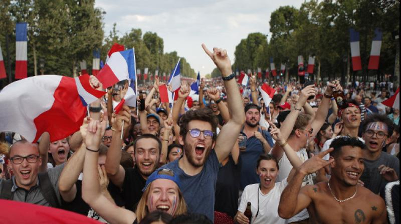 With flags, song, pride, French celebrate unifying victory