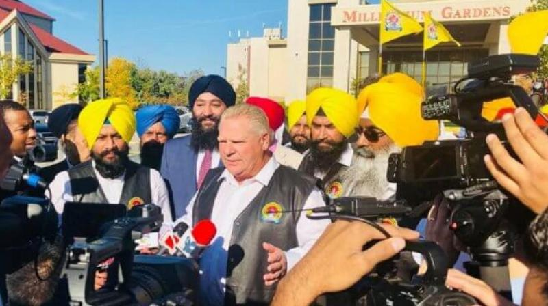 Doug Ford with Sikh community members