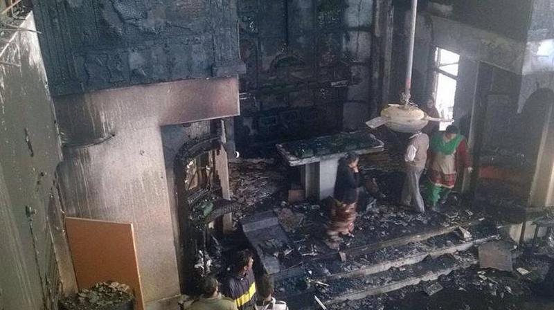 Three houses, seven shops gutted in fire