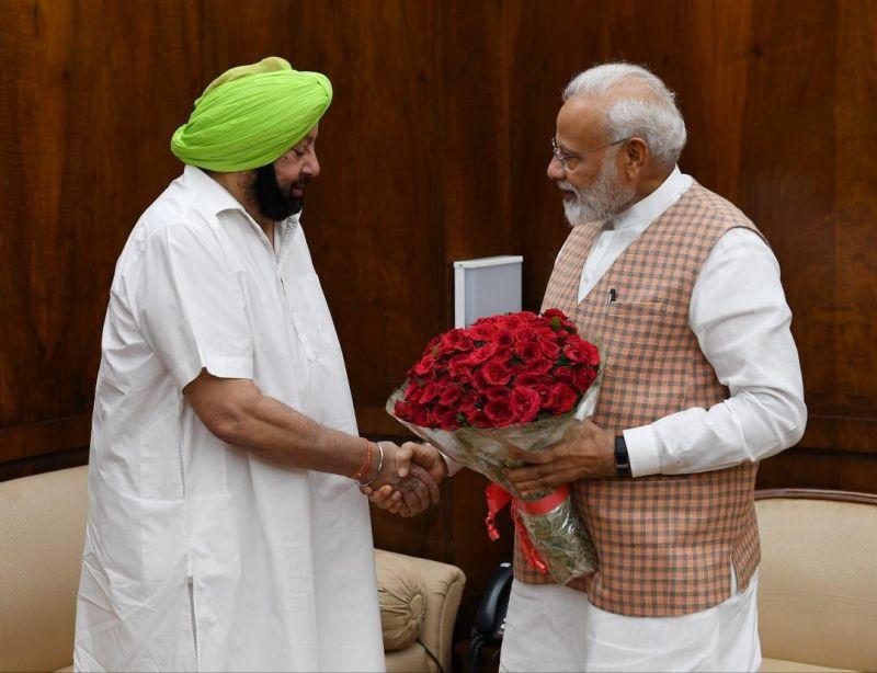 Captain Amarinder Singh and Narendra Modi
