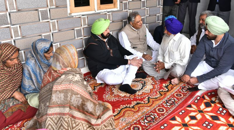 Captain Amarinder Singh sharing condolences with Darshan Singh, the father of Martyr Kulwinder Singh