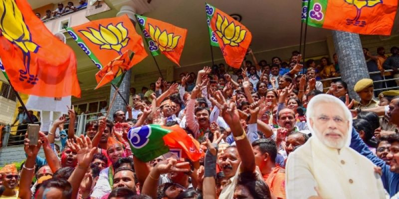 BJP workers celebrate the party's lead in Karnataka Assembly Election