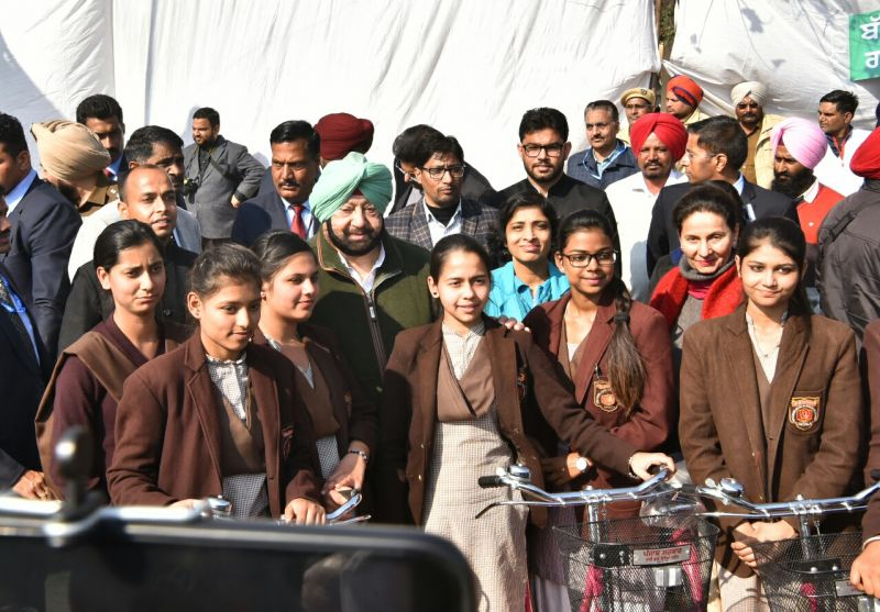 Captain Amarinder Singh distributing cycles to class XI and XII girl students