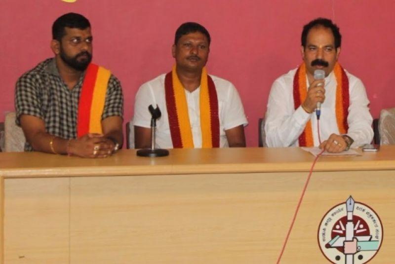 Praveen Shetty (right), an office bearer of the Karnataka Rakshana Vedike