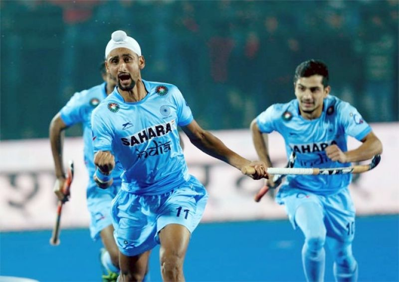 Mandeep Singh celebrates scoring for India