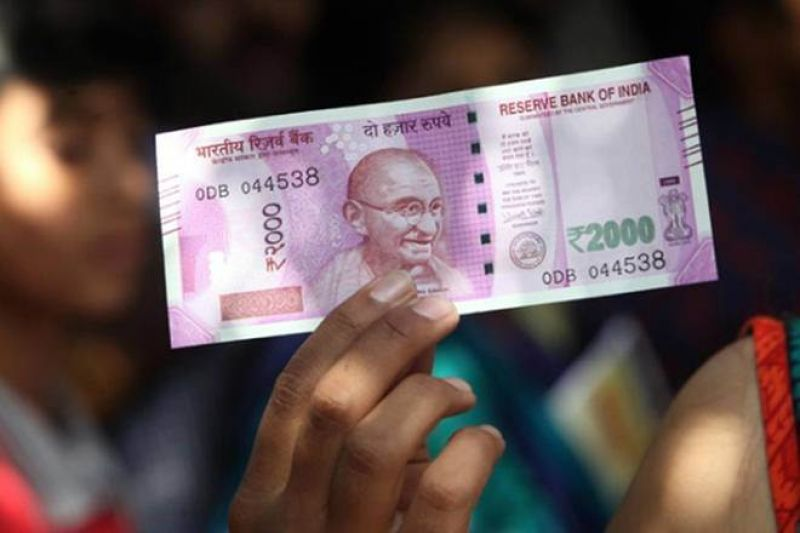 rupee hitting a new record low of 70.82 against the dollar