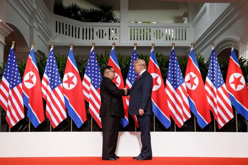 President Trump and North Korea's Kim Jong Un shake hands