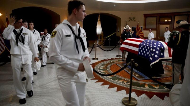 U.S. Naval sea cadets walk past the casket to pay their respects to Sen. John McCain