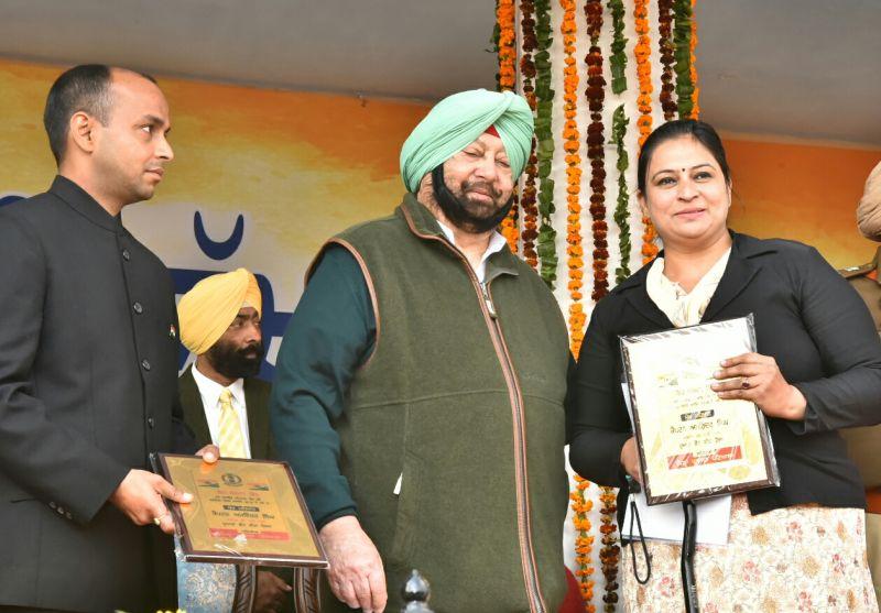 Captain Amarinder Singh honouring Assistant Professor of Rajiv Gandhi National University of Law