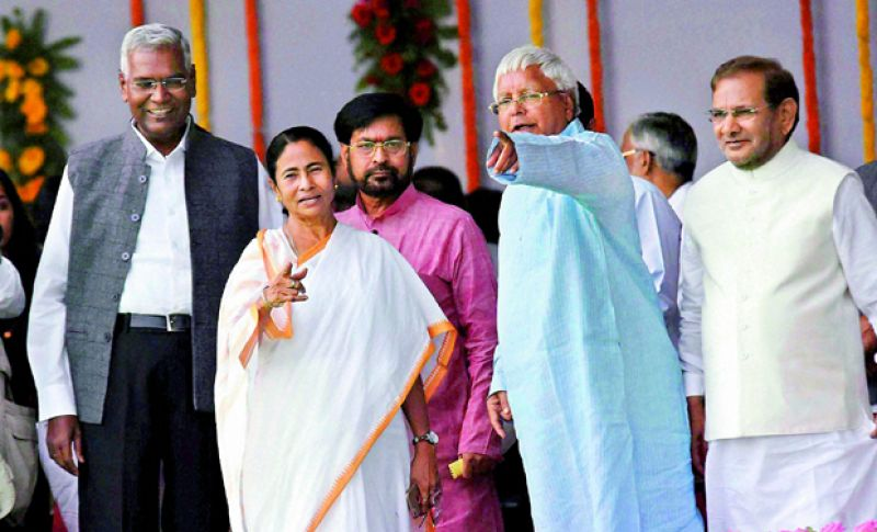 West Bengal counterpart Mamata Banerjee greets Lalu Yadav
